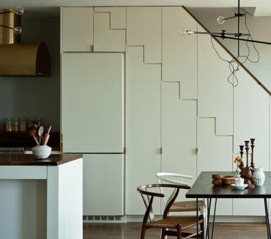 love the cabinet detail here + the gold hardware