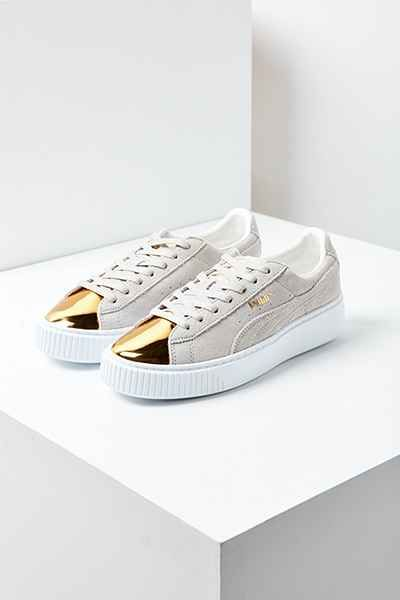 Put your best foot forward in sporty-chic style with these reinvented classic kicks from Puma. Heritage silhouette with a low-profile lace-up cut in a soft, durable suede with branded overlays at sides. Made with a metallic patent leather toe and finished with a thick platform sole and padded footbed.