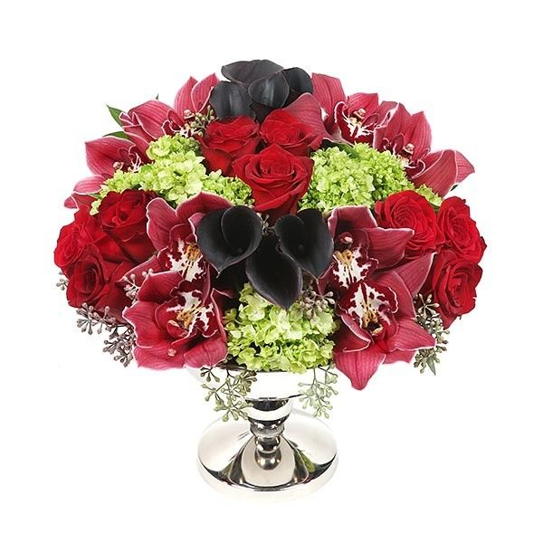 Classic deep red roses coupled with stunning dark red cymbidium orchids, eggplant calla lilies, green mini hydrangeas and decorative seeded eucalyptus.  Imperial Merlot - Roses Calla Lilies Hydrangeas Orchids - Flower Delivery NYC - plantshed.com