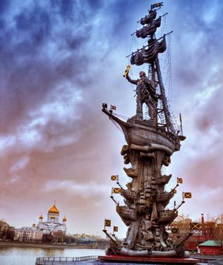 """Peter the Great Statue, Moscow  aka """"300 Years of the Russian Fleet"""". 1996. One of the tallest outdoor statues in the world at over 300 feet, the statue depicts Peter the Great standing on top of a galleon stacked upon a series of other ships. Sculptor Zurab Tsereteli originally intended it to be a statue of Christopher Columbus. When the Americas and Spain didn't want it, he lobbed off Chris's head and replaced it with Peter's."""
