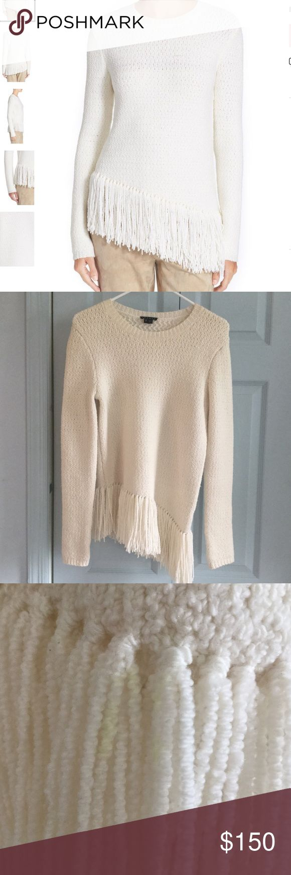 """NWOT Theory """"Hudina R"""" Fringe Merino Sweater Super cute sweater with an asymmetrical bottom. I just got the highlighter on it when I was marking things I've listed off and dropped the highlighter right on it- I'm sure this will come out after a wash, but I didn't want to take away from its new condition. This is SO soft and comfortable. It will be perfect for this time of year/spring. Cream/off-white color. Purchased from Nordstrom; no longer in stock. Theory Sweaters Crew & Scoop Necks"""