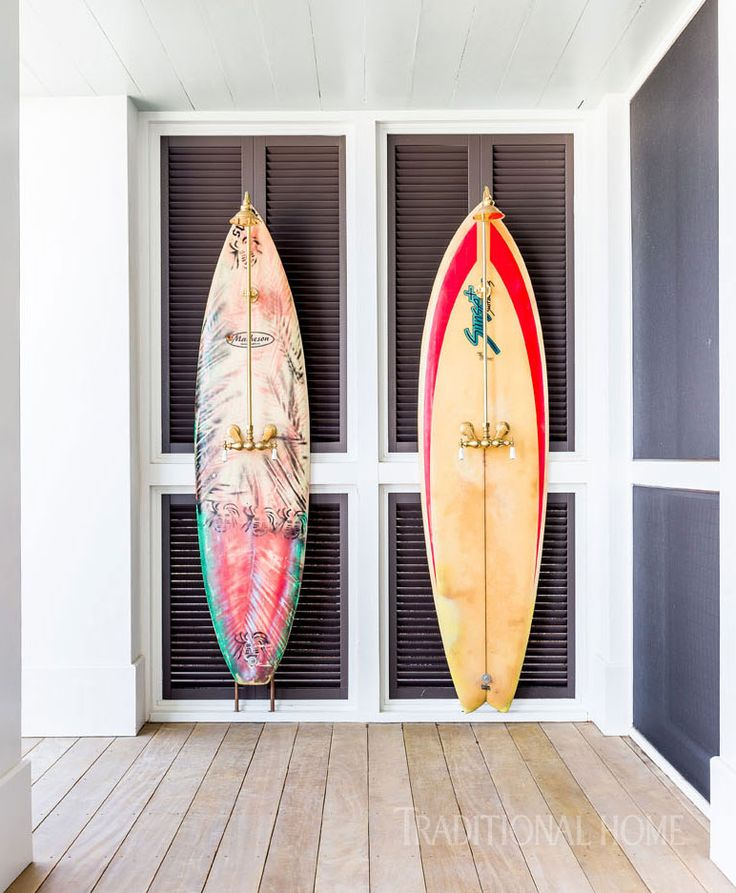 outdoor shower with surfboard as back drop - Luke Bryan's beach house