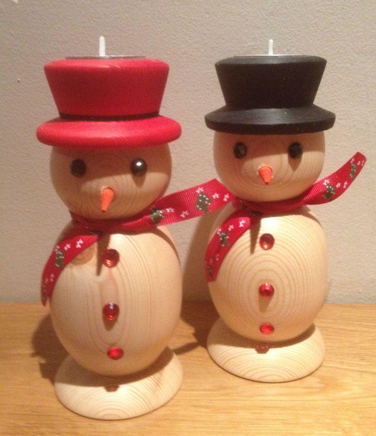 Wood turned snowmen with tea lights in their hats, by Kieran Reynolds