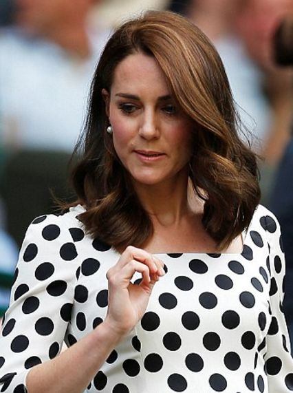 Catherine, Duchess of Cambridge, waves as she arrives at The All England Lawn Tennis Club in Wimbledon, southwest London, on July 3, 2017 on the first day of the 2017 Wimbledon Championships.