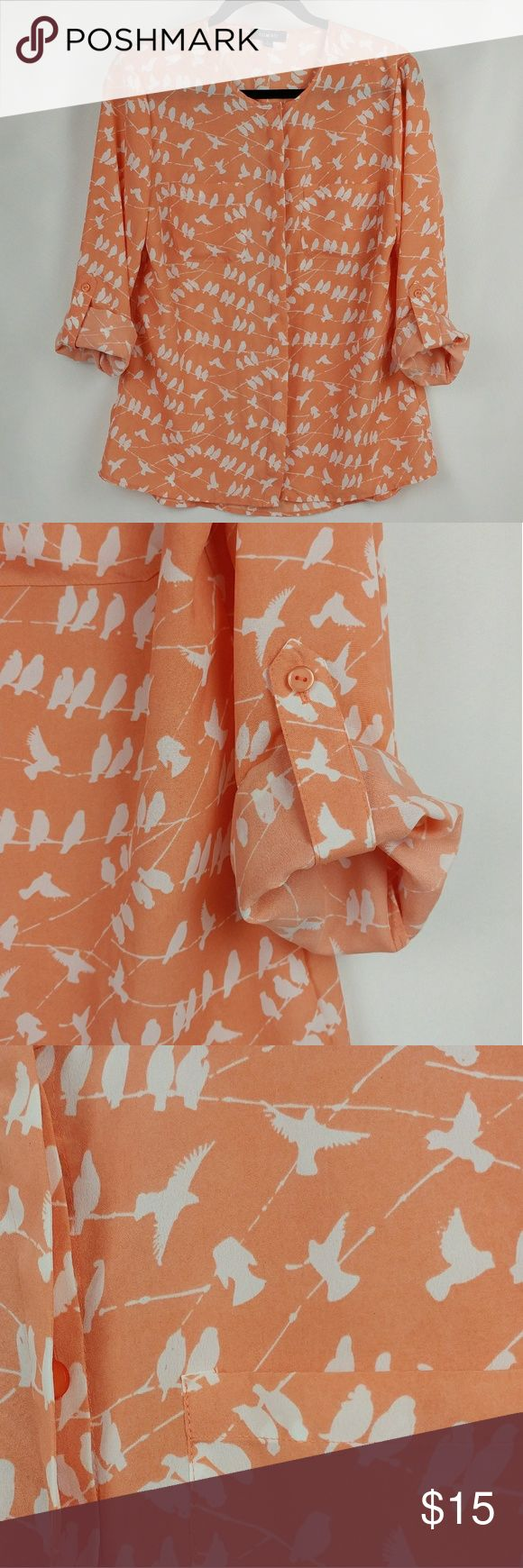 """Elementz Bird print coral/peach roll up sleeve top Elementz Bird print coral/peach color top with roll up sleeves and hidden buttons. 100% polyester. Armpit to armpit measuring laying flat 19.5"""" Length 25"""" in the front Length 27.7"""" in the back Waist 19"""" flat across In good gently used condition. Element Tops Button Down Shirts"""