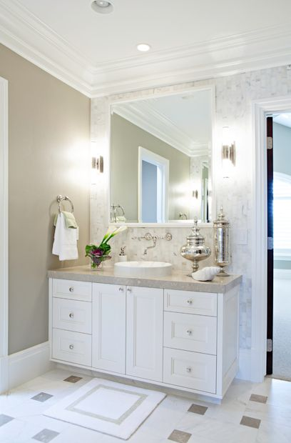 Elizabeth Kimberly Design: Elegant bathrrom with cafe au lait colored walls and carrara marble tiles accent wall. ...