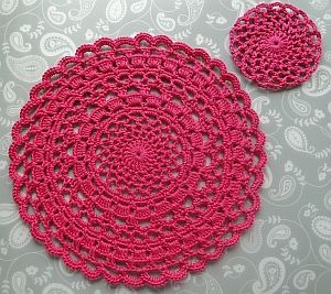 Circular pink lacy crochet doily