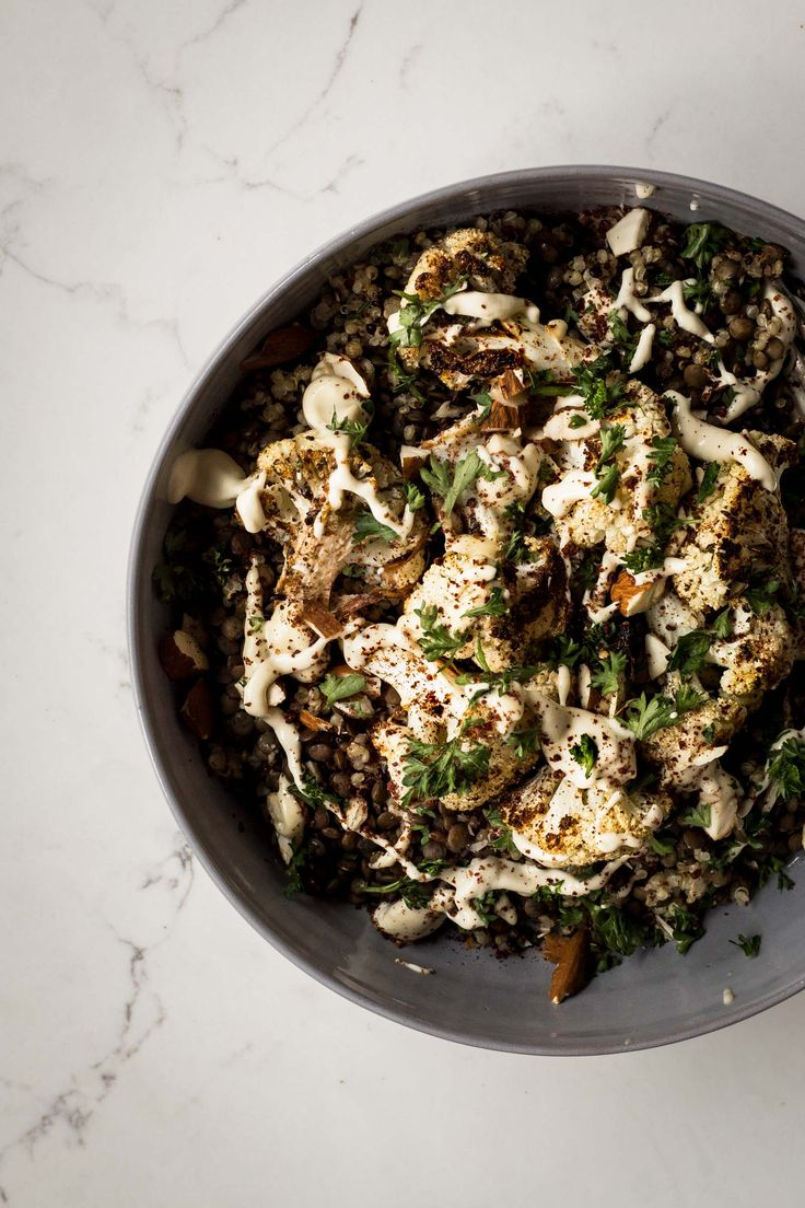"""It's been a while since we've had a good """"bowl"""" meal and this roasted veggie dish is on point. The za'atar roasted cauliflower is so darn flavorful it was hard resisting eating the whole sheet pan before we actually sat down to eat. We tossed the crispy cauliflower with some cooked lentils, quinoa and drizzled …"""