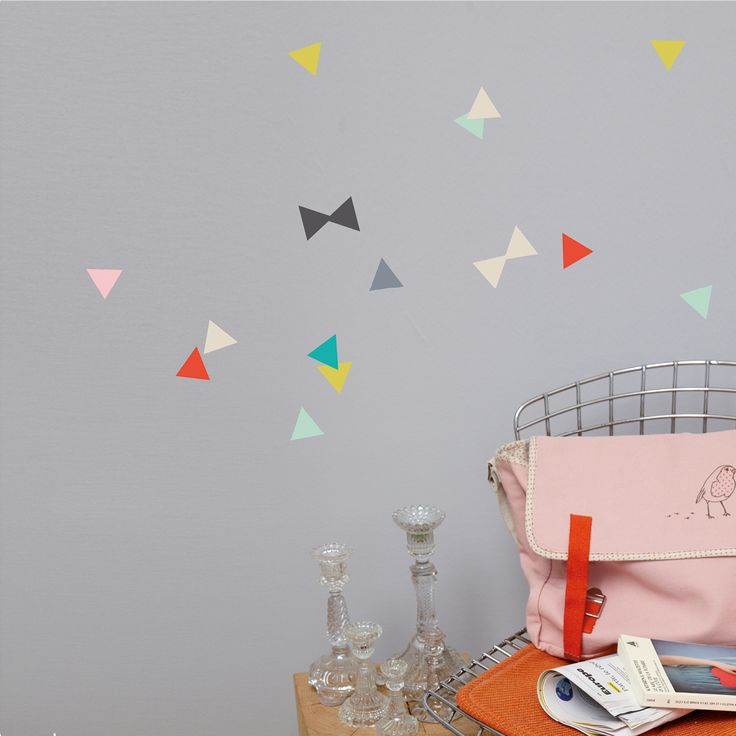 Love these triangle wall stickers.  The perfect color palette, and love how they styled them - looks so fresh.