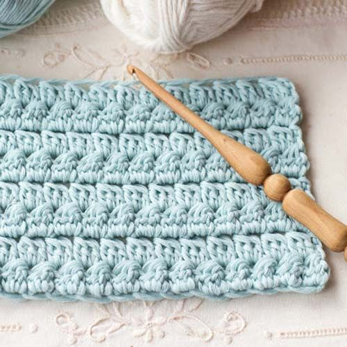 Crochet Cluster Stitch Video Tutorial - A fairly simple crochet stitch to add to your arsenal. Watch the video in the original post, for the full tutorial.