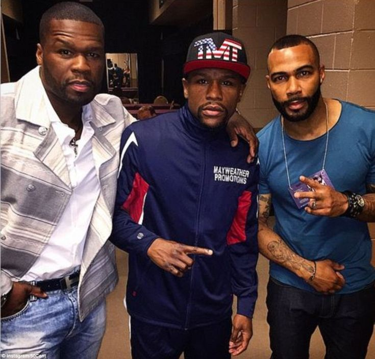 Mayweather poses with rapper 50 cent and actor Omari Hardwick ahead of Saturday's big figh...