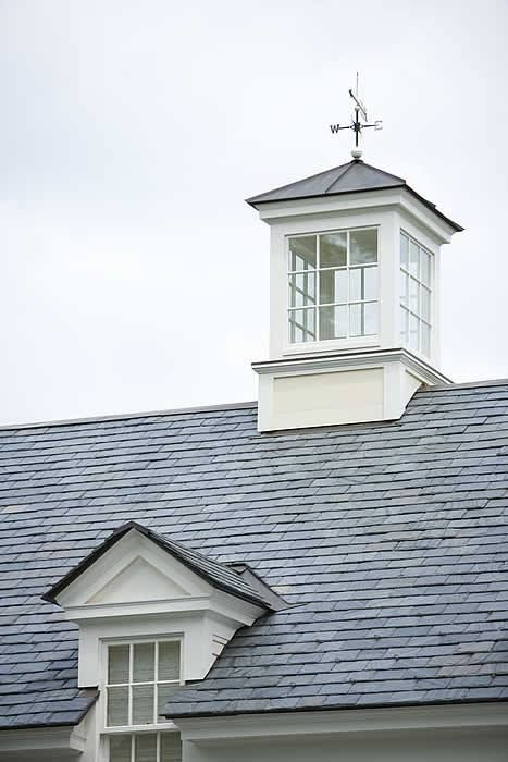 Cupola on the roof- bringing in the light and with a light inside acting like a lighthouse. Needs an awesome weathervane of course!
