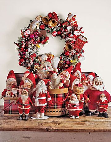 Santa Display If you have a collection of holiday decorations, try displaying similar objects together, like the Santa toys shown here. The wreath was made by hot-gluing a quirky selection of decorations to a base.