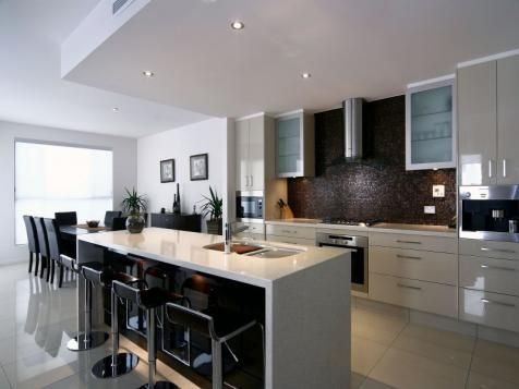 white floor white kitchen with black kick board