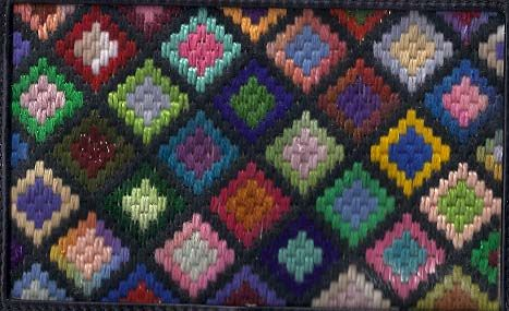 Nana's afghan, adapted from Granny's Square crochet from Needlepoint Stash Club. Image & project copyright Napa Needlepoint.