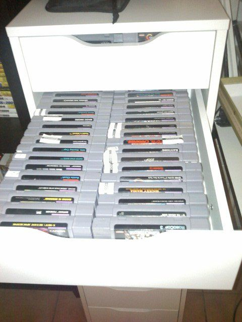 the Ikea Alex drawer unit's is great for storing old video games such as the  Nintendo games and you can use the bigger bottom ones for the Controllers and excess stuff. :)