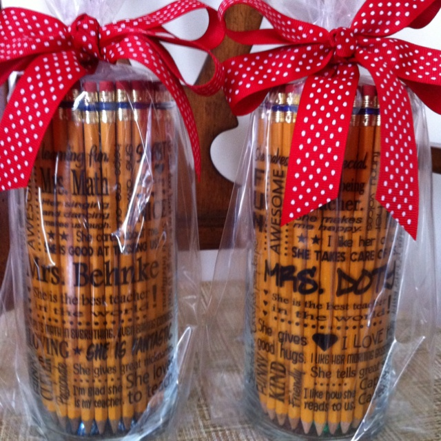 Teacher gifts. I asked the class to tell me about the teacher & designed the print using their words. Printed onto inkjet vinyl clings & put onto glass cylinders. Filled with pencils, pens & candy. For this project, I merged a couple of ideas I've seen on Pinterest. Teachers loved them!