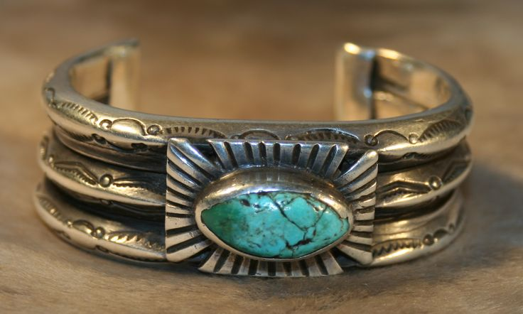A truly great classic piece of jewelry with three heavy silver ingot bars, Maltese cross, single stone, Navajo bracelet, circa 1905