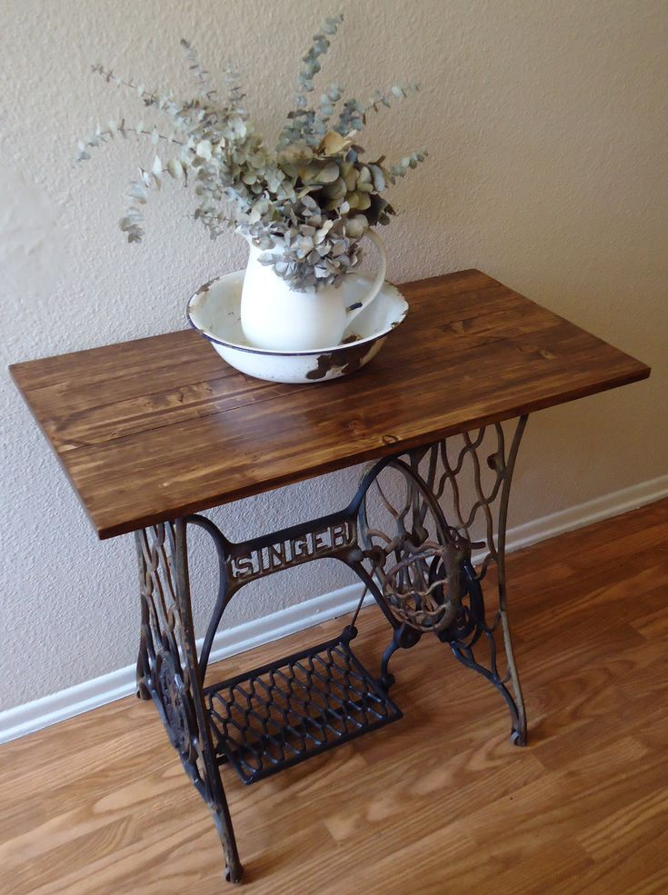 interesting how things my grandparents and great-grandparents had are cool again! Singer Treadle into accent table....