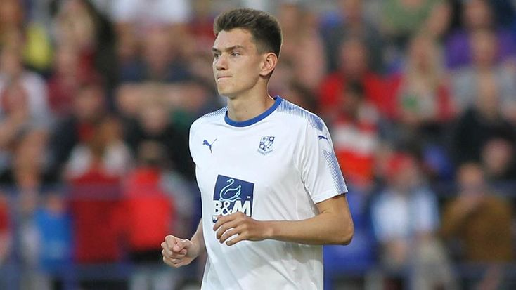 Tranmere Rovers winger Elliot Rokka's loan with Colwyn Bay has been extended by a month.