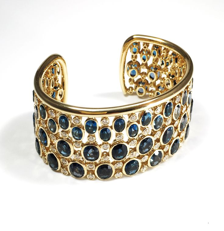 London Blue Topaz cuff with Diamonds mounted in yellow Gold. Custom design by Kathaline Page-Guth