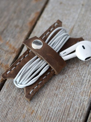 Keep his earbuds tangle-free with this rugged made-in-Utah leather cord keeper.