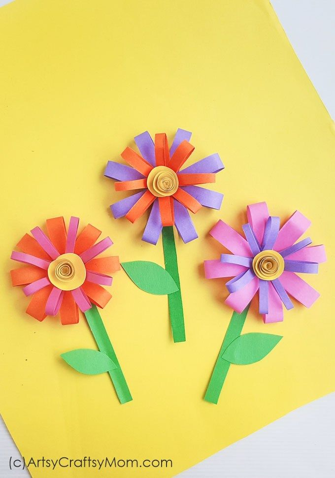 Brighten up your summer days with a paper flower craft that's super easy to make! Make several flowers in different colors for your room. #papercraft #paperflower #summercraft #artsycraftsymom