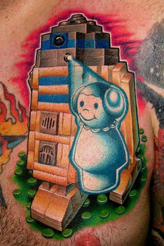 R2-D2 and Princess Leia Star Wars chest tattoo ink, by Nate Beavers and Jeff Ens