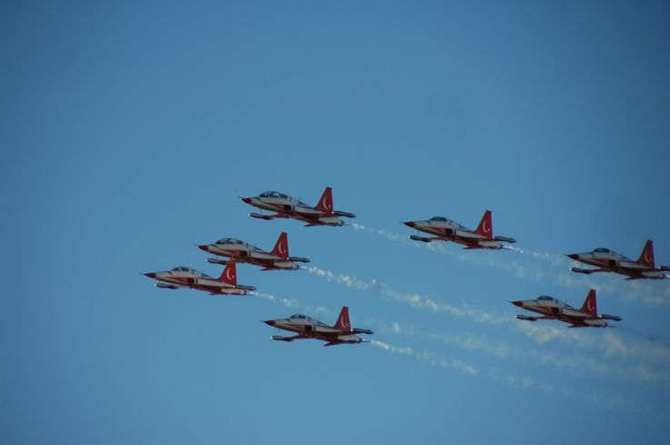 turkish stars flying in formation with smoke coming of the tails