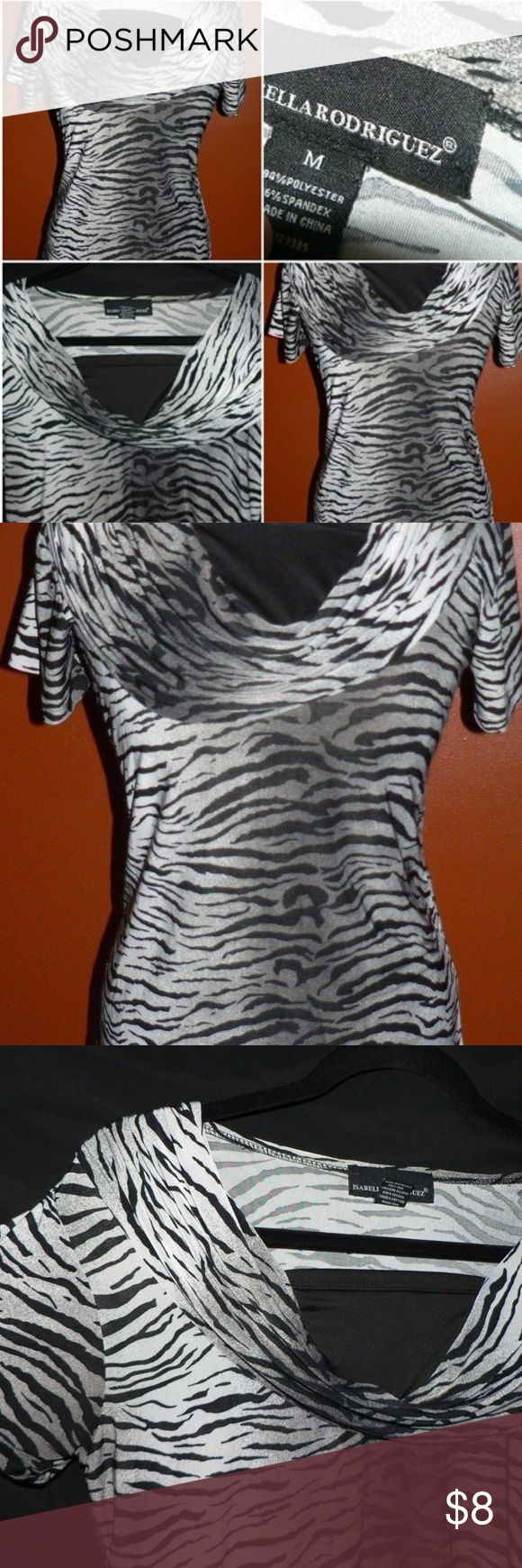"ISABELLA RODRIGUEZ ""Zebra"" Stretchy Blouse Top M Pretty Isabella Rodriguez Blouse Ladies sz: Medium Polyester & Spandex blend. Quite stretchy! Loose collar top for a Great Look- Approx. 34"" Around & Will Stretch, 24"" Inches length. While not brand new, the item is in EXCELLENT Condition isabella rodriguez Tops Blouses"