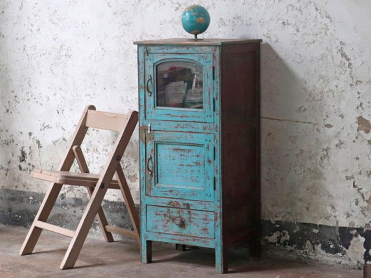 A wonderful vintage narrow cupboard with an original pastel blue shabby chic painted finish. The storage cupboard has upper and lower storage areas. #vintage #vintagefurniture #homedecor #vintagecabinet