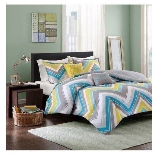 Its updated chevron design uses two shades of blue along with a pop of yellow and gray to update your space instantly. Two decorative pillows use embroidery in corresponding colors to showcase the chevron and a large medallion design.   eBay!