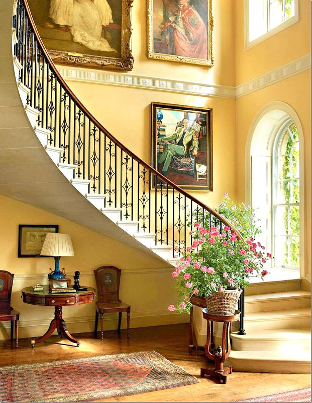 elegant, traditional foyer with sweeping staircase, yellow walls, palladian windows.  DesignNashville.com offers free custom drapery designs for homes of this style (shipping world wide)