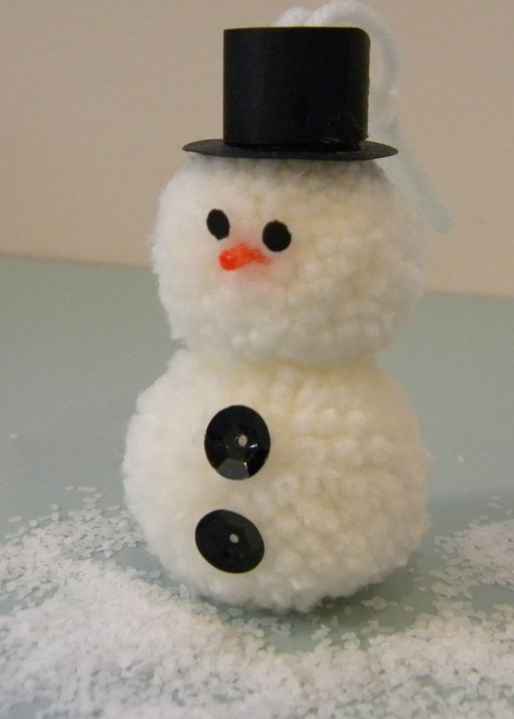 homework: Sew and Tell: pom pom snowman ornament (made out of homemade pompoms like the warm fuzzies we made in school)