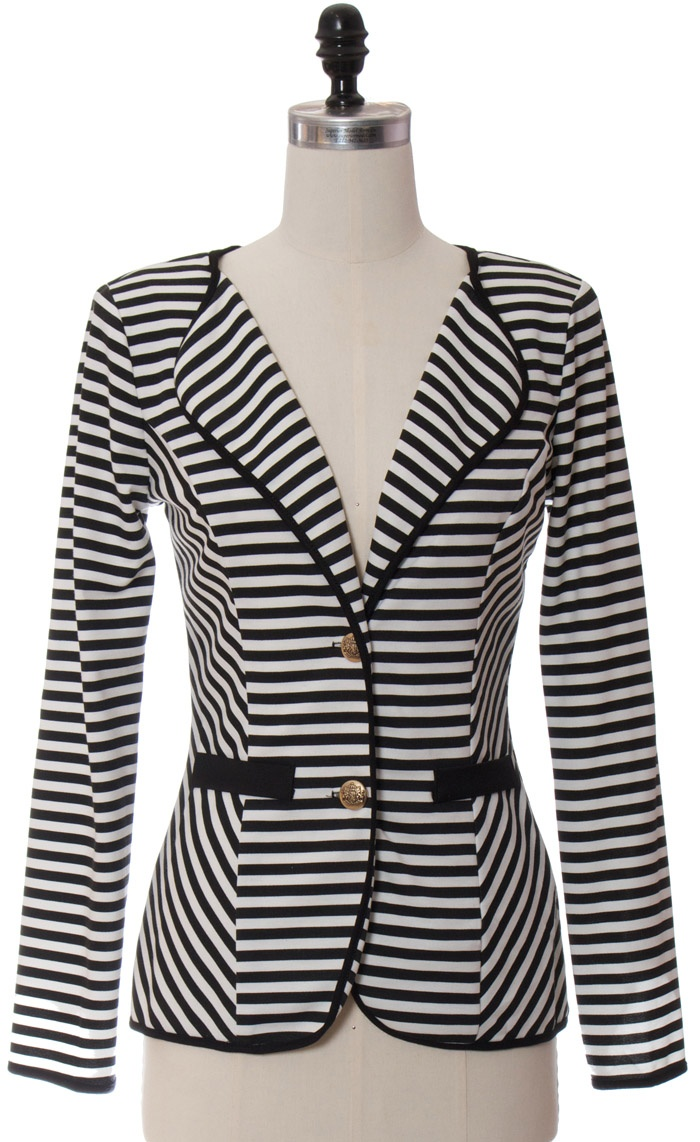 I saw this or something similar yesterday. I love the collarless lapels on it. Almost picked it up.
