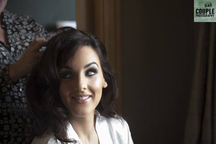 The bride getting her hair done. Weddings at Druids Glen Resort by Couple Photography.