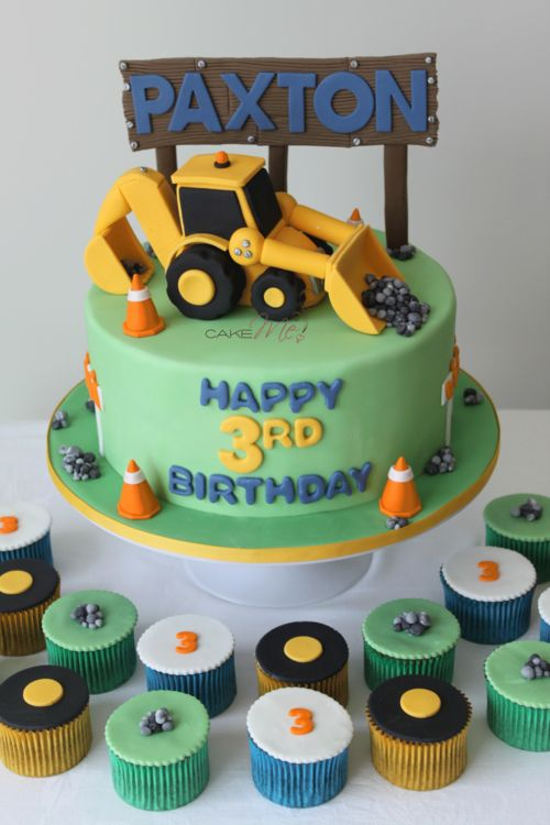 Construction themed cake with digger front end loader.  www.cakeme.com.au