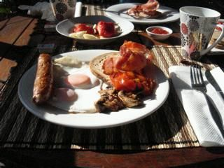 a good old fashioned Aussie breakfast of sausage, poached egg, tomato, mushrooms and fresh bacon