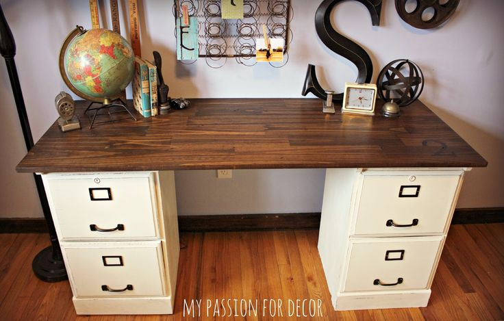 Pottery Barn desk hack... Goodwill oak file cabinets painted with chalk paint and a solid piece of wood from Lowe's stained