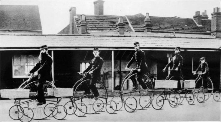 Postmen on Penny Farthing cycles fitted with training wheels in Melbourne, Australia. (Photo undated) v@e
