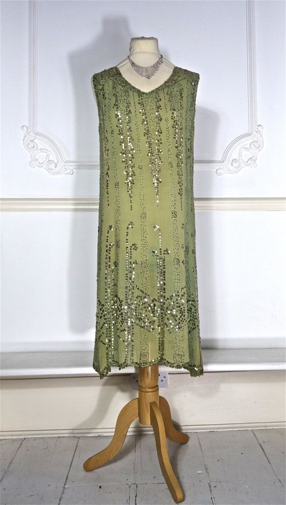Beautiful forest green 1920s beaded dress with gold sequin detail. Because this is made of cotton, it is strong and can be worn. Condition Very good. Overall fading, but this is only noticeable in certain lights. There is a small spot on the front where this colour variation is more perceptible. There may also be one or two missing beads and sequins. Size This would be suitable for a size medium. All measurements are approximate:  Bust - 36 inches Hips - up to 38 inches Waist - up to 38…