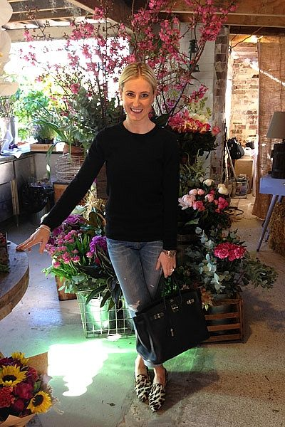 """""""En route to pick up flowers for a client gift at The Grounds Florals By Silvia, wearing Jac & Jack top, Levi's jeans, Prada shoes, Hermes Birkin Bag and a Rose Gold Rolex Daytona watch."""""""