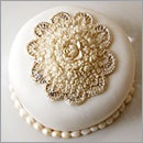 This individual wedding cake is decorated with baroque details.: Fondant Cake