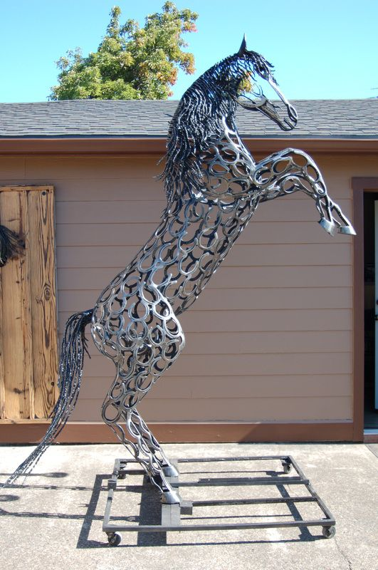 'Kaspar' - sculpted from recycled horseshoes by Bud Thomas of Oregon Horseshoe Art;  stands 9.5 feet tall;  he has a 'wilder mane and fierce stance' than 'Gabriel' (another horse sculpter by Thomas);  even the mane, tail, face and each hoof are made by heating and shaping the horseshoes