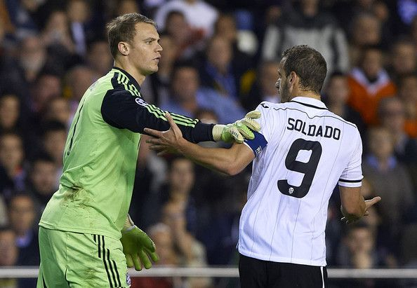 Manuel Neuer (L) of Bayern Muenchen reacts to Roberto Soldado of Valencia during the UEFA Champions League group F match between Valencia CF and FC Bayern Muenchen at Estadio Mestalla on November 20, 2012 in Valencia, Spain.