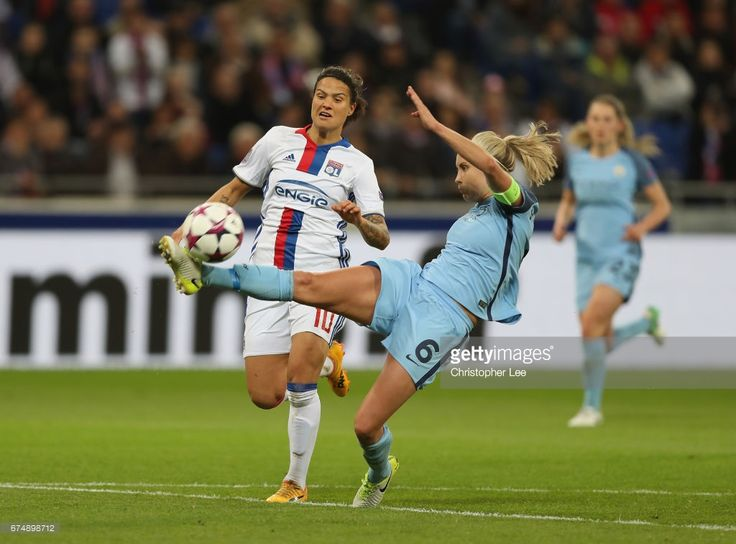 Steph Houghton of Manchester City clears the ball from Dzsenifer Marozsan of Olympique Lyon during the UEFA Women's Champions League Semi Final second leg match between Olympique Lyon and Manchester City at the Stade de Lyon on April 29, 2017 in Lyon, France.