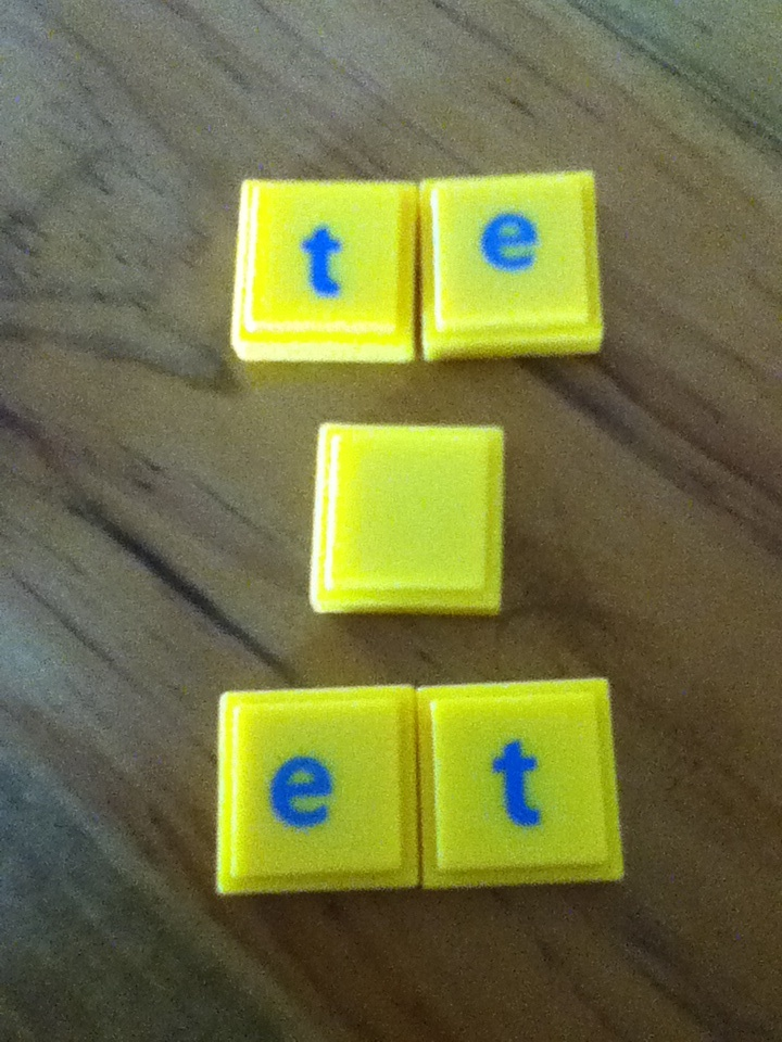 Ummmmmm!!!  What word can I spell with these letters.