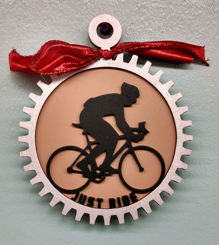 A personal favorite from my Etsy shop https://www.etsy.com/listing/184740663/bicycle-rider-just-ride-ornament