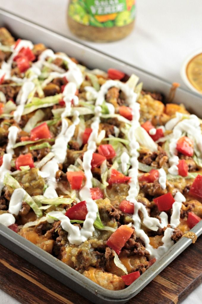 Loaded Beef Tater Tots Totchos Feature Nacho Ingredients Ground Beef Cheese Sour Cream Salsa And Tomatoes On Tater Tot Tater Tot Totchos Totchos Recipe