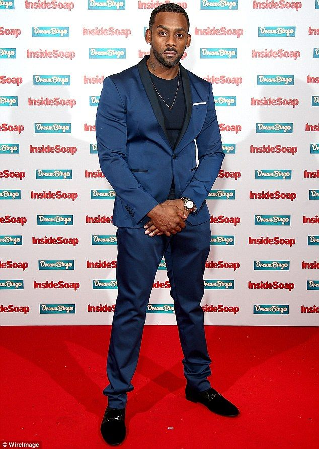 Suave style: Richard Blackwood hit the red carpet alongside other members of the cast of EastEnders, cutting a suave figure in a dark blue suit and black suede loafers